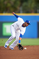 Dunedin Blue Jays shortstop Richard Urena (5) fields a ground ball during a game against the Palm Beach Cardinals on April 15, 2016 at Florida Auto Exchange Stadium in Dunedin, Florida.  Dunedin defeated Palm Beach 8-7.  (Mike Janes/Four Seam Images)