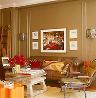 The large framed photographic print above an antique leather sofa in the library is a work by Christopher Simon Sykes and is flanked by four small etchings by Lucian Freud