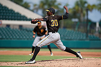 Pittsburgh Pirates pitcher Yerry De Los Santos (30) delivers a pitch during a Florida Instructional League game against the Detroit Tigers on October 6, 2018 at Joker Marchant Stadium in Lakeland, Florida.  (Mike Janes/Four Seam Images)