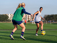 ORLANDO, FL - JANUARY 21: Lindsey Horan #9 defends Lynn Williams #6 of the USWNT during a training session at the practice fields on January 21, 2021 in Orlando, Florida.