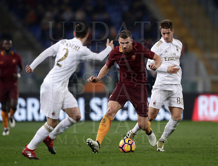 Calcio, Serie A: Roma vs Milan. Roma, stadio Olimpico, 12 dicembre 2016.<br /> Roma's Edin Dzeko, center, is challenged by Milan's Mattia De Sciglio, left, and Mario Pasalic during the Italian Serie A football match between Roma and AC Milan at Rome's Olympic stadium, 12 December 2016.<br /> UPDATE IMAGES PRESS/Isabella Bonotto