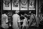 Customers at a sweet shop in Kolkata, India.