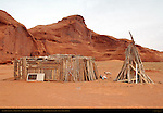 Navajo Outbuilding and Traditional High-Desert Wood Stack, Monument Valley Navajo Tribal Park, Navajo Nation Reservation, Utah/Arizona Border