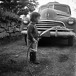 Pleasant Hills PA: Cathleen Brady Stewart helping dad wash the 1946 Chevrolet.