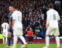9th October 2021; Hampden Park, Glasgow, Scotland; FIFA World Cup football qualification, Scotland versus Israel;  Referee performs a VAR check after initially ruling out Lyndon Dykes of Scotland goal in the 57th minute that made it 2-2