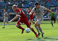 HOOVER, AL - DECEMBER 09, 2012: Caleb Konstanski (22) of Indiana University chases after Brandon Allen (10) of Georgetown University during the NCAA 2012 Men's College Cup championship, at Regions Park, in Hoover , AL, on Sunday, December 09, 2012.