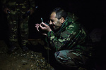 One of the lieutenant of the checkpoint is checking his compass to orientate the mortar launcher,Kunar, Afghanistan, 15th November 2017. <br /> <br /> Un des commandants du poste avancé vérifie sa boussole pour orienter le lanceur de mortier, Kunar, Afghanistan, 15 novembre 2017.