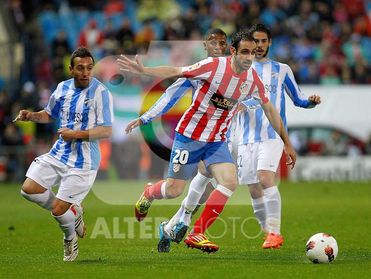 Atletico de Madrid's Juanfran Torres (r) Malaga's Santiago Cazorla  during La Liga match, 2012/May/05..(ALTERPHOTOS/ARNEDO & ALCONADA)