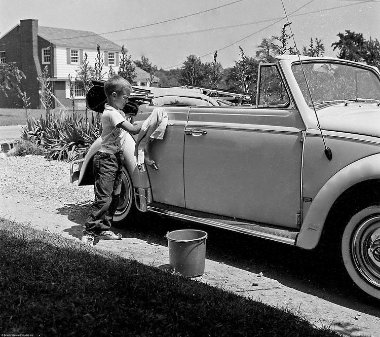Bethel Park PA:  View of Michael Stewart washing the Stewart's new Volkswagen Beetle convertible.