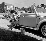 Bethel Park PA:  View of Michael Stewart washing the Stewart's new Volkswagen Beetle convertible.