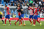 Atletico de Madrid´s Fernando Torres, Gabi and Antoine Griezmann celebrate their victory at 2015/16 La Liga match between Real Madrid and Atletico de Madrid at Santiago Bernabeu stadium in Madrid, Spain. February 27, 2016. (ALTERPHOTOS/Victor Blanco)