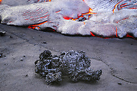 Sunrise, Large fast moving lava flow covering a new black sand beach, Fresh chunks of lava on a black sand beach, The lava chunks were swept onto the beach by large waves prior to the flow covering the beach, Quarry flow, Ki ocean entry, Near Hawaii Volcanoes National Park, Kalapana, Hawaii, Big Island, Hawaii, USA, Pacific Ocean