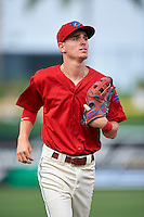 Clearwater Threshers center fielder Carlos Tocci (15) jogs to the dugout during a game against the Charlotte Stone Crabs on April 12, 2016 at Bright House Field in Clearwater, Florida.  Charlotte defeated Clearwater 2-1.  (Mike Janes/Four Seam Images)
