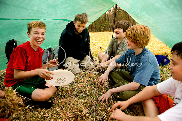 Troop 10 Boy Scouts escape the rain during a spring backpacking in the South Mountains State Park in Connelly Springs, North Carolina.