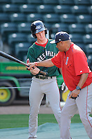 Hitting coach Nelson Paulino works with outfielder Derek Miller (16) of the Greenville Drive during a preseason workout on  Wednesday, April 8, 2015, the day before Opening Day, at Fluor Field at the West End in Greenville, South Carolina. (Tom Priddy/Four Seam Images)