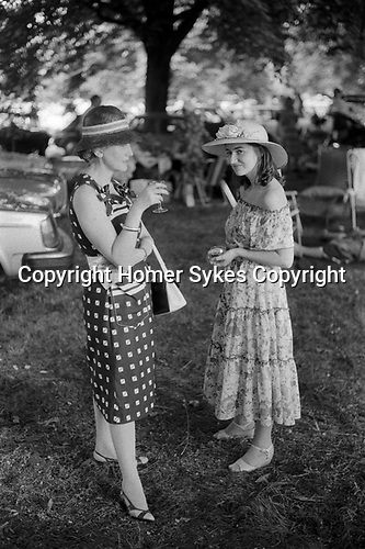 Wealthy upper class English women 1970s UK. Eton College 70s Parents Day, The Fourth of June. Mother and sister of student during inter-house cricket match picnic interval on Agar's Plough. 1978 England