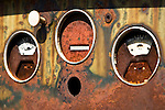Close-up of details on old, rusted car