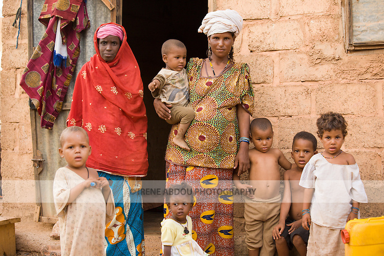 Ouagadougou, Burkina Faso: July 6, 2007.  Touareg and Fulani neighbors stand together in front of a house in Ouagadougou, Burkina Faso.  The Fulani and Touareg are traditionally pastoralist, roaming the African plains with herds of cattle, goats, and sheep.