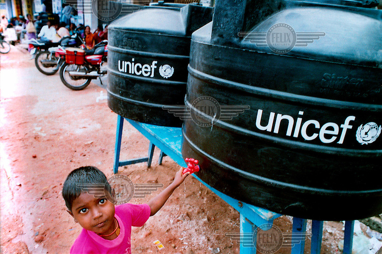 A young boy next to a water tap installed by Unicef in the wake of the tsunami which struck South Asia on 26/12/2004..An underwater earthquake measuring 9 on the Richter scale triggered a series of tidal waves which caused devastation when they struck dry land. 12 countries were affected by the tsunami, with a combined death toll of over 150,000.