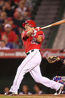 Los Angeles Angels outfielder Mike Trout #27 bats against the Texas Rangers at Angel Stadium on September 27, 2011 in Anaheim,California. Texas defeated Los Angeles 10-3.(Larry Goren/Four Seam Images)