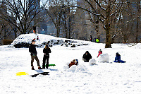 NEW YORK, NEW YORK - FEBRUARY 21: A family plays in Central Park covered by snow and ice  on February 21, 2021 in New York City. The big apple waits this monday the last snowfall before a midweek warm up.  (Photo by John Smith/VIEWpress via Getty Images)