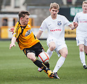 Alloa's Mitchel Megginson and Ayr Utd's Neil McGregor challenge for the ball.