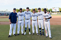 Joe Szekely (33), Ronaldo Hernandez (10), Matt Krook (16), Phoenix Sanders (52), Dalton Moats (39), and Lucius Fox (5), all members of the Peoria Javelinas and Tampa Bay Rays organization, pose for a photo after winning the Arizona Fall League Championship game against the Salt River Rafters at Scottsdale Stadium on November 17, 2018 in Scottsdale, Arizona. Peoria defeated Salt River 3-2 in 10 innings. (Zachary Lucy/Four Seam Images)