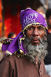 This man stood out of the Sunday afternoon crowds at the Kamakhya Temple of Guwahati with his gold trimmed purple headscarf and flowing beard.