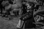 A little girl like a toy. Photo by Sanad Ltefa
