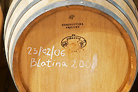 Oak barrel with chalked text saying Blatina Hercegovina Produkt winery, Citluk, near Mostar. Federation Bosne i Hercegovine. Bosnia Herzegovina, Europe.