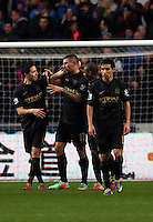 Wednesday, 01 January 2014<br /> Pictured: Aleksandar Korolov of Manchester City (C) is celebrating his goal with team mate Samir Nasri (L), making the score 3-1 to his team<br /> Re: Barclay's Premier League, Swansea City FC v Manchester City at the Liberty Stadium, south Wales.
