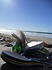 This beach picture was taken in November 2012 and is on the beach at Tijuana, Mexico. The beach is located right next to the American Border. The book resting on the flip flops is Bob Dylan's autobiography. <br /> <br /> Stock Photo by Matt Bergin