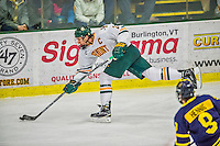 21 February 2015:  University of Vermont Catamount Defenseman Michael Paliotta, a Senior from Westport, CT, takes a slap-shot in the second period against the Merrimack College Warriors at Gutterson Fieldhouse in Burlington, Vermont. The teams played to a scoreless tie as the Cats wrapped up their Hockey East regular home season. Mandatory Credit: Ed Wolfstein Photo *** RAW (NEF) Image File Available ***