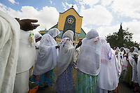 Eritrea. Maekel province. Asmara. St Michael church. A crowd of black women, covering their heads with white veils (cotton loincloth), are praying on St Michael's day during an orthodox religious service.  © 2006 Didier Ruef
