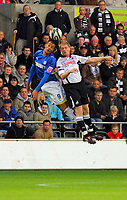 ATTENTION SPORTS PICTURE DESK<br /> Pictured: Alan Tate of Swansea (R) battling for the ball against Jay Bothroyd of Cardiff (L)<br /> Re: Coca Cola Championship, Swansea City Football Club v Cardiff City FC at the Liberty Stadium, Swansea, south Wales. Saturday 07 November 2009