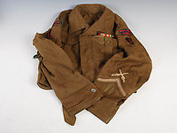 BNPS.co.uk (01202 558833)<br /> Pic: LindsayBurns/BNPS<br /> <br /> Pictured: Marine Jock Mathieson's battledress blouse.<br /> <br /> The medals, weapons and personal effects of a hero D-Day commando have sold for over £11,000 - 22 times their estimate.<br /> <br /> Marine Jock Mathieson narrowly escaped death during the Normandy landings on June 6, 1944.<br /> <br /> A bullet pierced the fuel tank of his motorbike which he was carrying above his head while wading through the sea towards Juno Beach.