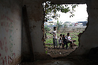 A group of your boys gather outside an abandoned building in central Jakarta. Numerous buildings are found abandoned on the banks of the city's 13 rivers, as people flee the regular floods that engulf homes and communities throughout the city.