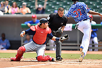 Mississippi Braves catcher Alex Jackson (25) tags out Oscar De La Cruz (37) as home plate umpire Jonathan Parra prepares to make the call during a game against the Tennessee Smokies at Smokies Stadium on May 20, 2018 in Kodak, Tennessee. The Braves defeated the Smokies 7-4. (Tony Farlow/Four Seam Images)