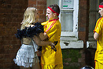 © Joel Goodman - 07973 332324 . 27/12/2017. Wigan, UK. An argument between a man and a woman in which a woman hits the man with a costume prop and then the man grabs the woman around the neck. Revellers in Wigan enjoy Boxing Day drinks and clubbing in Wigan Wallgate . In recent years a tradition has been established in which people go out wearing fancy-dress costumes on Boxing Day night . Photo credit : Joel Goodman
