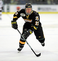 2 January 2009: University of Vermont Catamounts' defenseman Josh Burrows, a Sophomore from Prairie Grove, IL, in action against the Colgate Raiders during the second game of the 2009 Catamount Cup Ice Hockey Tournament hosted by the University of Vermont at Gutterson Fieldhouse in Burlington, Vermont. The Catamounts defeated the Raiders 6-4 to move onto the championship game against the St. Lawrence Saints...Mandatory Photo Credit: Ed Wolfstein Photo