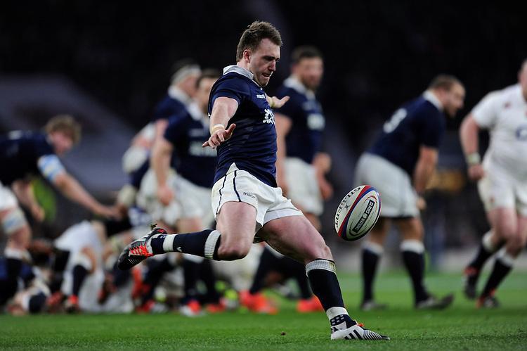 Stuart Hogg of Scotland clears his line