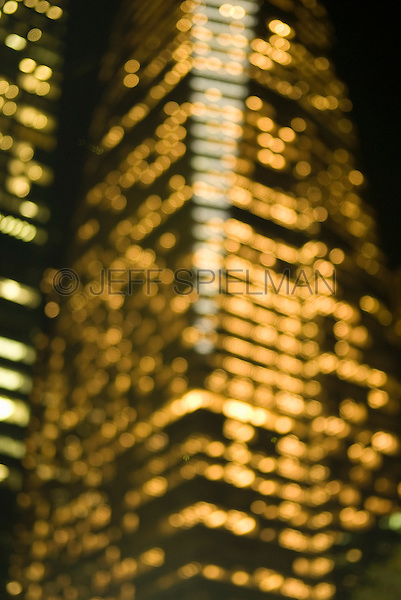 AVAILABLE FROM WWW.PLAINPICTURE.COM FOR LICENSING.  Please go to www.plainpicture.com and search for image # p5690254.<br /> <br /> Defocused View of the Bank of America Tower Illuminated at Night, One Bryant Park, 42nd Street and Avenue of the Americas (6th Avenue), Midtown Manhattan, New York City, New York State, USA