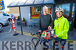 Mary Dillane ready for action with her bike as she is ready to make a delivery in Abbeydorney on Wednesday standing with her husband Dermot.