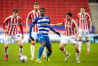 6th February 2021; Bet365 Stadium, Stoke, Staffordshire, England; English Football League Championship Football, Stoke City versus Reading; Lucas Joao of Reading under pressure from Jack Clarke and Joe Allen of Stoke City