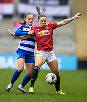 7th February 2021; Leigh Sports Village, Lancashire, England; Women's English Super League, Manchester United Women versus Reading Women; Kirsty Hanson of Manchester United Women is tackled by Kristine Bjordal Leine of Reading