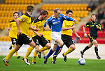 St Johnstone v Livingston...24.08.11   Scottish Communities League Cup Round 2.Steven Anderson closed down by Liam Fox and Kyle Jacobs.Picture by Graeme Hart..Copyright Perthshire Picture Agency.Tel: 01738 623350  Mobile: 07990 594431