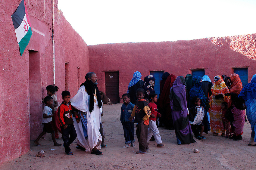 Children plays after a meeting in ausserd on December 13, 2003, in the Saharawi refugee camps. Saharawi people have been living at the refugee camps of the Algerian desert named Hamada, or desert of the deserts, for more than 30 years now. Saharawi people have suffered the consecuences of European colonialism and the war against occupation by Moroccan forces. Polisario and Moroccan Army are in conflict since 1975 when Hassan II, Moroccan King in 1975, sent more than 250.000 civilians and soldiers to colonize the Western Sahara when Spain left the country. Since 1991 they are in a peace process without any outcome so far. (Ander Gillenea / Bostok Photo)