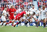 Photo: Richard Lane/Richard Lane Photography. England v Wales. RBS Six Nations. 09/03/2014. England's Luther Burrell attacks.