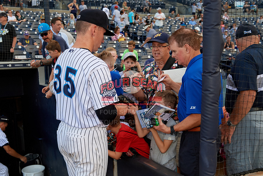 Tampa Tarpons pitcher Trevor Stephan (35) signs autographs after a Florida State League game against the Jupiter Hammerheads on July 26, 2019 at George M. Steinbrenner Field in Tampa, Florida.  Stephan struck out 9 batters over 7 innings for a no-hitter in the first game of a doubleheader.  Tampa defeated Jupiter 2-0.  (Mike Janes/Four Seam Images)
