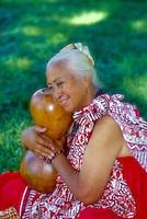 Kumu hula, (teacher) with ipuheke gourd